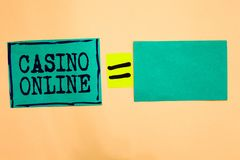 Handwriting text Casino Online. Concept meaning Computer Poker Game Gamble Royal Bet Lotto High Stakes Turquoise paper notes remin. Ders equal sign important royalty free stock photography