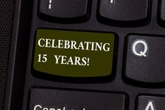 Handwriting text Celebrating 15 Years. Concept meaning Commemorating a special day after 15 years anniversary Keyboard. Key Intention to create computer message royalty free stock images
