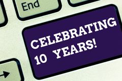 Handwriting text Celebrating 10 Years. Concept meaning Commemorating a special day Decennial anniversary Keyboard key. Intention to create computer message stock photo