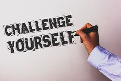 Handwriting text Challenge Yourself. Concept meaning Overcome Confidence Strong Encouragement Improvement Dare Advisors hand holdi. Ng black marker whiteboard royalty free stock photos