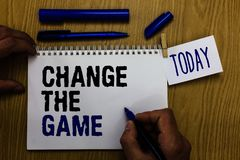 Handwriting text Change The Game. Concept meaning Make a movement do something different new strategies Man holding marker noteboo. K clothespin reminder wooden stock photography