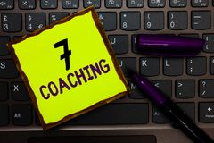 Handwriting text 7 Coaching. Concept meaning Refers to a number of figures regarding business to be succesful Yellow paper keyboar. D Inspiration communicate royalty free stock image