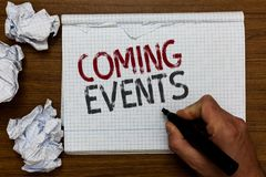 Handwriting text Coming Events. Concept meaning Happening soon Forthcoming Planned meet Upcoming In the Future Man holding marker. Notebook crumpled papers Stock Photos