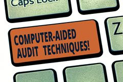 Handwriting text Computer Aided Audit Techniques. Concept meaning Using computer to automate IT audit process Keyboard key stock illustration