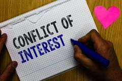 Handwriting text Conflict Of Interest. Concept meaning disagreeing with someone about goals or targets Paper register multiline te stock image