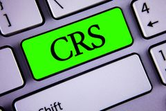 Handwriting text Crs. Concept meaning Common reporting standard for sharing tax financial information written on Green Key Button. Handwriting text Crs. Concept Stock Photography