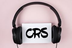 Handwriting text Crs. Concept meaning Common reporting standard for sharing tax financial information written on White Sticky Note. Handwriting text Crs. Concept Royalty Free Stock Photo