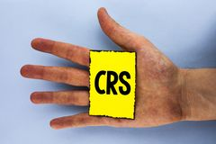 Handwriting text Crs. Concept meaning Common reporting standard for sharing tax financial information written on Yellow Sticky Not. Handwriting text Crs. Concept Royalty Free Stock Photography