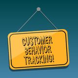 Handwriting text Customer Behavior Tracking. Concept meaning Action that a user takes related to your company Blank. Hanging Color Door Window Signage with royalty free illustration