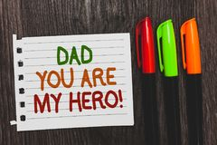 Handwriting text Dad You Are My Hero. Concept meaning Admiration for your father love feelings compliment Colorful words with whit. E page red green orange pen royalty free stock photo