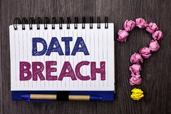 Handwriting text Data Breach. Concept meaning Stolen Cybercrime Information Hacking Security Malicious Crack written on Notebook B. Handwriting text Data Breach Stock Image