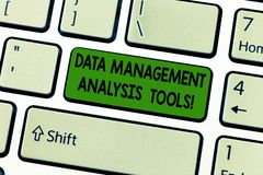 Handwriting text Data Management Analysis Tools. Concept meaning Business research technical system tool Keyboard key royalty free stock image