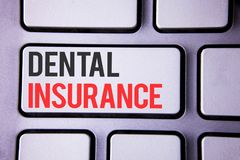 Handwriting text Dental Insurance. Concept meaning Dentist healthcare provision coverage plans claims benefit written on white key. Handwriting text Dental Royalty Free Stock Image