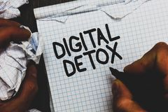 Handwriting text Digital Detox. Concept meaning Free of Electronic Devices Disconnect to Reconnect Unplugged Man holding marker no. Tebook crumpled papers ripped stock image