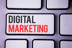 Handwriting text Digital Marketing. Concept meaning Strategy of products services digital technologies online written on white key Stock Photos
