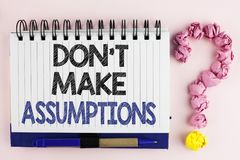 Handwriting text Do not Make Assumptions. Concept meaning predict events future without clue Alternative Facts written on Notebook. Handwriting text Do not Make royalty free stock image
