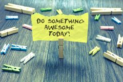 Handwriting text Do Something Awesome Today. Concept meaning Make an incredible action motivate yourself Paperclip hold written to. Rn page many clips laid on Royalty Free Stock Image