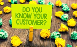 Handwriting text Do You Know Your Customer question. Concept meaning Have into account client likes opinion Paperclip retain writt. En words yellow paper paper stock images