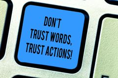 Handwriting text Don T Trust Words Trust Actions. Concept meaning Less talking more things done action taken Keyboard. Key Intention to create computer message stock image