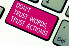 Handwriting text Don T Trust Words Trust Actions. Concept meaning Less talking more things done action taken Keyboard. Key Intention to create computer message stock images
