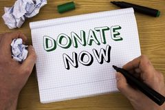 Handwriting text Donate Now. Concept meaning Give something to charity Be an organ donor Help others. Concept For Information. Handwriting text Donate Now stock photos
