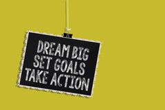 Handwriting text Dream Big Set Goals Take Action. Concept meaning Motivation to follow your dreams Inspiration Hanging blackboard. Message communication stock illustration