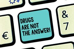 Handwriting text Drugs Are Not The Answer. Concept meaning Addiction problems good advice to help health Keyboard key. Intention to create computer message stock photo