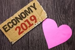 Handwriting text Economy 2019. Concept meaning Financial Currency Growth Market Earnings Trade Money written on Cardboard Piece on. Handwriting text Economy 2019 Stock Image
