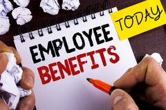Handwriting text Employee Benefits. Concept meaning list of advantage recruiter get at work Insurance written by Man on Notepad on. Handwriting text Employee Royalty Free Stock Photography