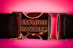 Handwriting text Employee Handbook. Concept meaning Document Manual Regulations Rules Guidebook Policy Code Words written black go. Ld bealt seatbelt trousers stock images