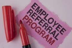 Handwriting text Employee Referral Program. Concept meaning strategy work encourage employers through prizes written on Tear Pink. Handwriting text Employee royalty free stock image