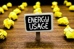 Handwriting text Energy Usage. Concept meaning Amount of energy consumed or used in a process or system Blackboard crumpled papers. Several tries mistake not stock photography
