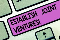 Handwriting text Establish Joint Ventures. Concept meaning Two or more companies invest in a certain business Keyboard key. Intention to create computer message royalty free stock images