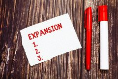 Handwriting text Expansion. Concept meaning action becoming larger or more extensive enlargement of something Blank Torn. Index sized Graph Paper Two Pens for royalty free stock images