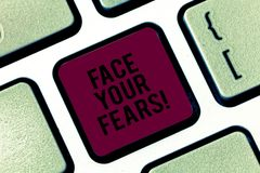 Handwriting text Face Your Fears. Concept meaning Have the courage to overcome anxiety be brave fearless Keyboard key. Intention to create computer message royalty free stock images
