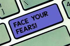 Handwriting text Face Your Fears. Concept meaning Have the courage to overcome anxiety be brave fearless Keyboard key. Intention to create computer message stock images