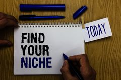 Handwriting text Find Your Niche. Concept meaning Market study seeking specific potential clients Marketing Man holding marker not. Ebook clothespin reminder stock photo