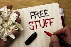 Handwriting text Free Stuff. Concept meaning Complementary Free of Cost Chargeless Gratis Costless Unpaid written by Man on Notebo. Handwriting text Free Stuff stock photo