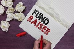 Handwriting text Fund Raiser. Concept meaning person whose job or task is seek financial support for charity Man holding marker no royalty free stock photo