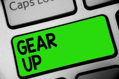 Handwriting text Gear Up. Concept meaning Asking someone to put his clothes or suit on Getting ready fast Keyboard green key Inten royalty free stock photo