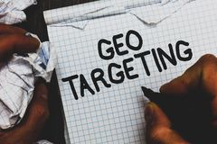 Handwriting text Geo Targeting. Concept meaning Digital Ads Views IP Address Adwords Campaigns Location Man holding marker noteboo. K crumpled papers ripped royalty free stock images