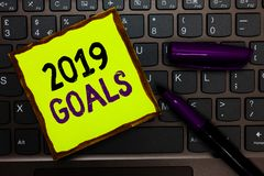 Handwriting text 2019 Goals. Concept meaning A plan to do for something new and better for the coming year Yellow paper keyboard I. Nspiration communicate ideas royalty free stock images