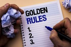 Handwriting text Golden Rules. Concept meaning Regulation Principles Core Purpose Plan Norm Policy Statement written by Man on Not. Handwriting text Golden Rules Royalty Free Stock Photo