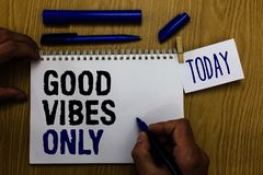 Handwriting text Good Vibes Only. Concept meaning Just positive emotions feelings No negative energies Man holding marker notebook. Clothespin reminder wooden Stock Photos