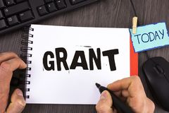 Handwriting text Grant. Concept meaning Money given by an organization or government for a purpose Scholarship written by Man on N. Handwriting text Grant Royalty Free Stock Photo