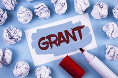 Handwriting text Grant. Concept meaning Money given by an organization or government for a purpose Scholarship written on Painted. Handwriting text Grant Stock Photography