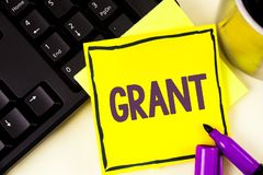 Handwriting text Grant. Concept meaning Money given by an organization or government for a purpose Scholarship written on Sticky N. Handwriting text Grant Royalty Free Stock Image