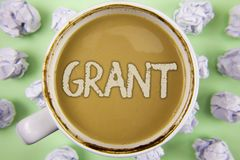 Handwriting text Grant. Concept meaning Money given by an organization or government for a purpose Scholarship written on Tea in W. Handwriting text Grant Stock Photos