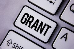 Handwriting text Grant. Concept meaning Money given by an organization or government for a purpose Scholarship written on the Whit. Handwriting text Grant Stock Photography
