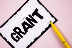 Handwriting text Grant. Concept meaning Money given by an organization or government for a purpose Scholarship written on White St. Handwriting text Grant Royalty Free Stock Image